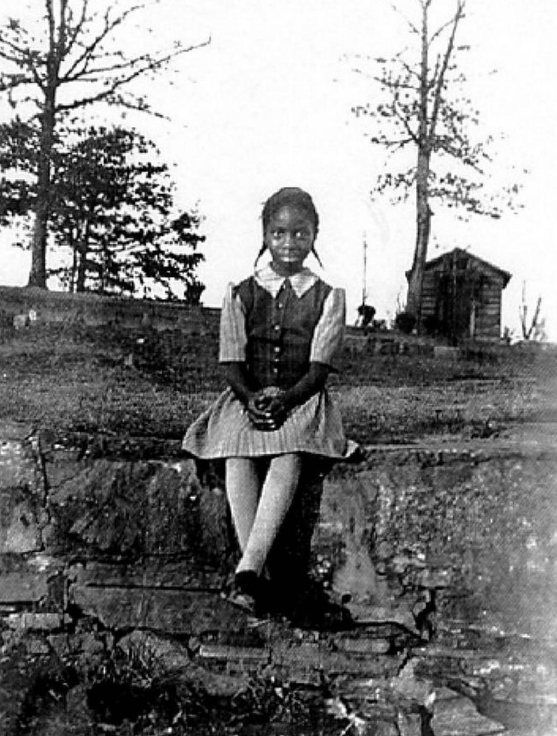 Nina Simone, age 8, in front of her home in Tryon, North Carolina.