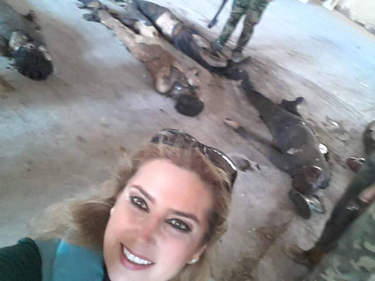 Pro-Assad reporter Kinana Allouche's infamous selfie with the corpses of Syrian rebels.