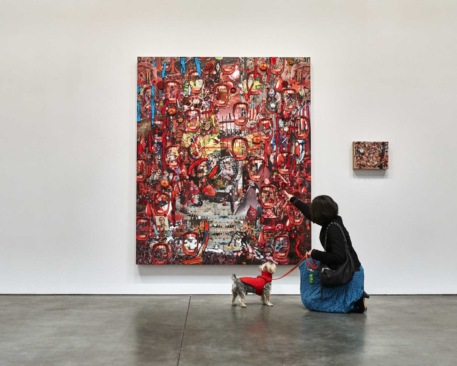 Jessica Dawson and Rocky with a painting by Elliott Hundley at Andrea Rosen Gallery.