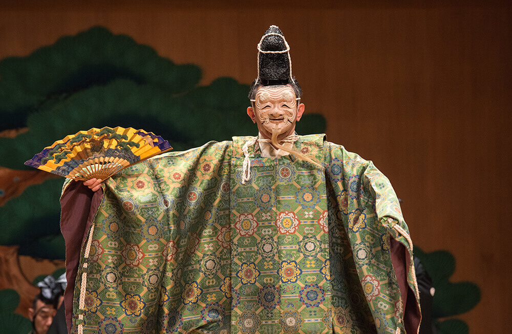 Kiyokazu Kanze (in mask) in <em>Okina</em>, July 13, 2016. Photo by Stephanie Berger.