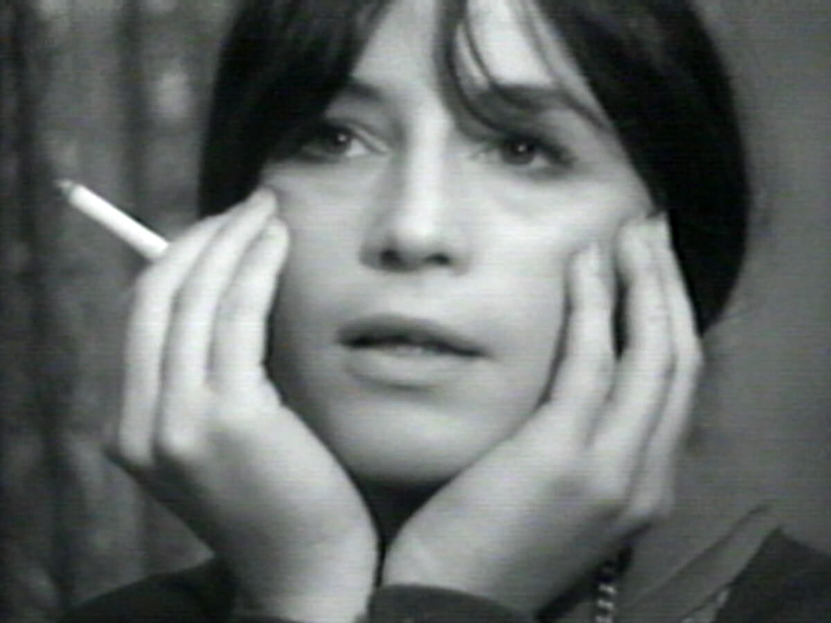 Carel smoking a cigarette during filming.