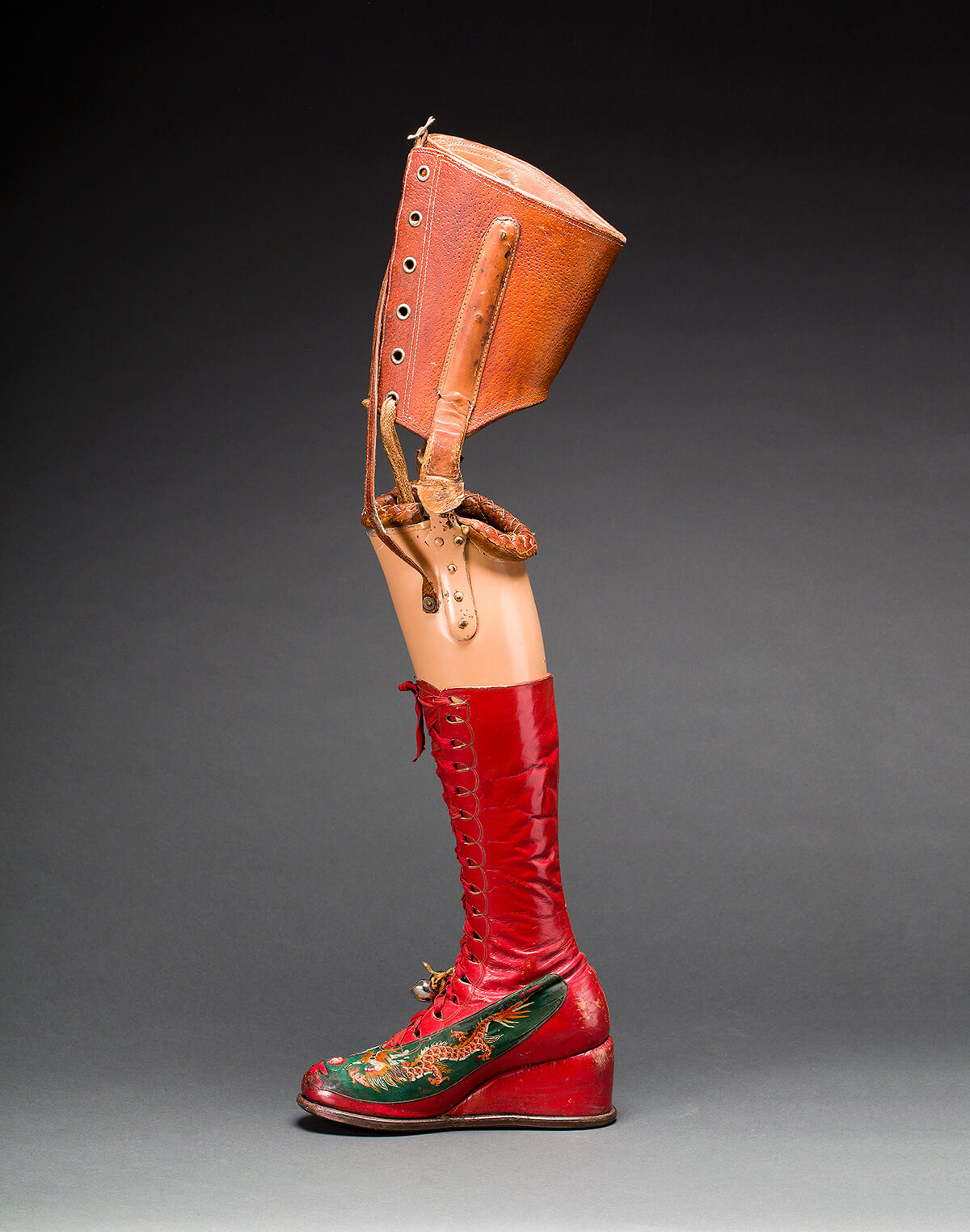 Frida Kahlo's prosthetic leg with leather boot. Applique?d silk with embroidered Chinese motifs. Photograph Javier Hinojosa. Museo Frida Kahlo. © Diego Riviera and Frida Kahlo Archives, Banco de Me?xico, Fiduciary of the Trust of the Diego Riviera and Frida Kahlo Museums.