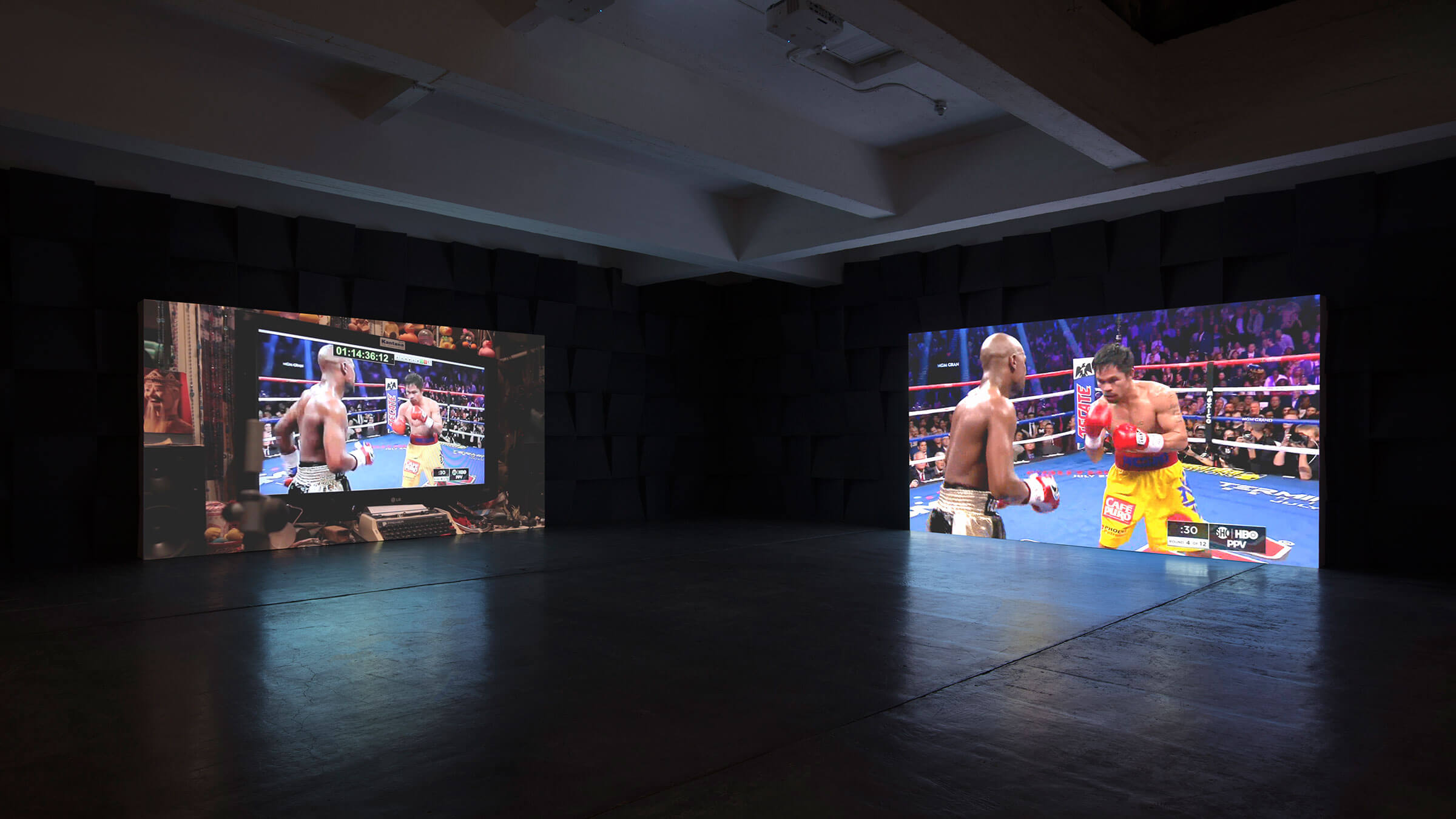 Paul Pfeiffer, <em>Three Figures In A Room</em>, 2015-16 two synced video channels on two projectors, four synced audio channels, Mac Minis  dimensions variable 48 minutes, looped © Paul Pfeiffer.